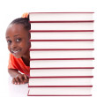 Cute black african american little girl hidden behind a stack of — Stock Photo