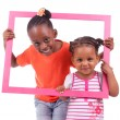 Little african american girls holding a picture frame — Stockfoto