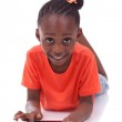 Little african american girl using a tablet pc — Stock Photo