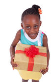 Young African American little girl holding a gift box — Stock Photo