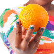 Overweight young black woman holding an orange - African — Stock Photo