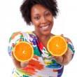 Overweight young black woman holding orange slices - African pe — Stock Photo