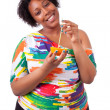 Overweight young black woman drinking orange juice - African peo — Stock Photo