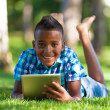 Outdoor portrait of student black boy using a tactile tablet - A — Stock Photo #29405575