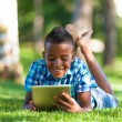 Outdoor portrait of student black boy using a tactile tablet - A — Stockfoto