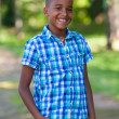 Outdoor portrait of a cute teenage black boy - African people — Stockfoto