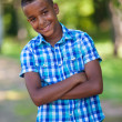 Outdoor portrait of a cute teenage black boy - African people — Stock Photo