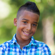 Stock Photo: Outdoor portrait of a cute teenage black boy - African people