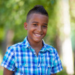 Outdoor portrait of a cute teenage black boy - African people — Stock Photo #29406261
