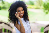 Teenage black girl using a mobile phone - African people — Stock Photo