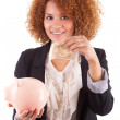 Young african american business woman holding a piggy bank - Afr — Stock Photo #31863693