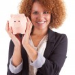 Young african american business woman holding a piggy bank - Afr — Stock Photo