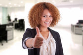 Portrait of a young african american business woman making thumb — Stock Photo