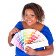 African American woman holding a color palette - Black people  — Stock Photo