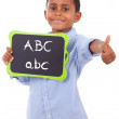 African American school boy holding a blank black board - Black  — Stock Photo