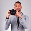 African american photographer holding a dslr camera - Black peop — Stock Photo #37886579