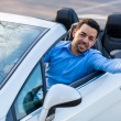 Young black latin american driver holding car keys driving his n — Stock Photo
