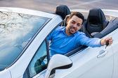 Young black latin american driver holding car keys driving his n — Stock Photo