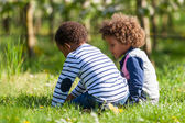 Cute african american little boys  playing outdoor - Black peopl — Stock Photo