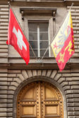Swiss and Geneva flag floating in the air — Stockfoto