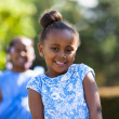Outdoor close up portrait of a cute young black girl - African p — Stock Photo #46291201