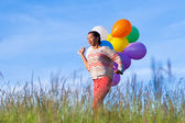 Outdoor portrait of a young African American teenage girl runnin — Stock Photo