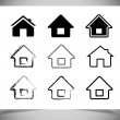 Vector black house icons set on white — Stock Vector