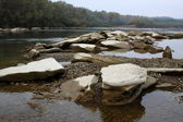 Enormous stones are in the mouth of the mountain river — Stock Photo