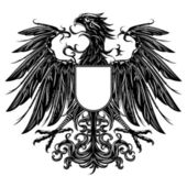 Heraldic style eagle isolated on white — Stock Vector