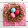Royalty-Free Stock Photo: Close-up of  easter eggs on white wooden table