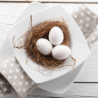 Stock Photo: Close-up of easter eggs on white wooden table