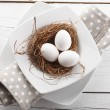 Close-up of easter eggs on white wooden table — Stock Photo #22526105