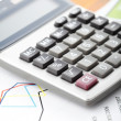 Financial data analyzing. Counting on calculator. — Stock Photo