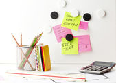 Desk with 'Post It' notes — Stock Photo