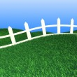 White fence on green grass — Stock Photo