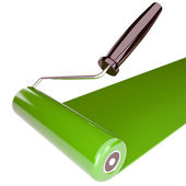 Roller with a green paint — Stock Photo