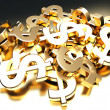 Heap of golden dollar signs — Stock Photo