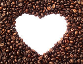 Frame in the shape of heart from coffee beans — Stock Photo