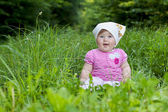 Baby in grass — Stock Photo