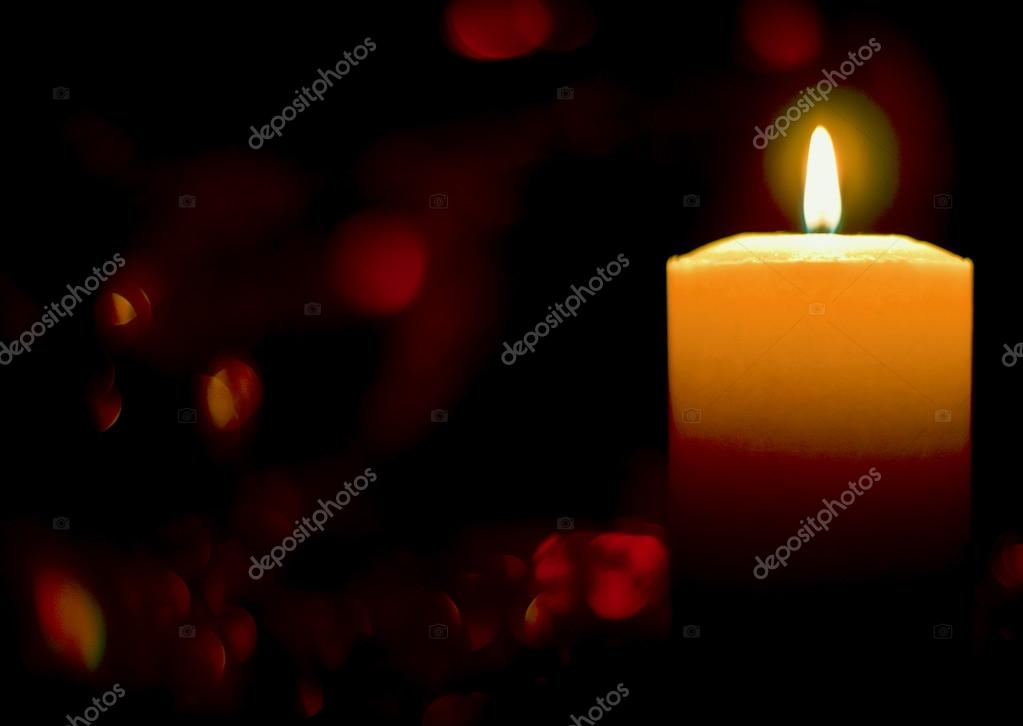Burning candle on a background of diffuse reflections  Stock Photo #14029891