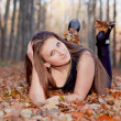 Girl in the autumn forest - Stock Photo