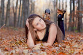 Girl in the autumn forest — Stock Photo