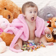 Little girl with toys — Stock Photo #22036397
