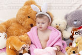 Little girl with toys — Stock Photo