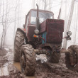 Tractor in the woods — Stock Photo