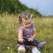 Little girl with a computer — Stock Photo
