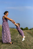 Mother with baby on nature — Stock Photo