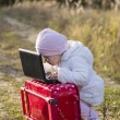 Foto Stock: Girl with suitcase