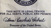 Inscription on the dollar — Stock Photo