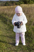 Small child with a camera — Stock Photo